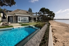 A Cape Cod-style beachfront house in Campbells Bay combined architect's vision and detailing with