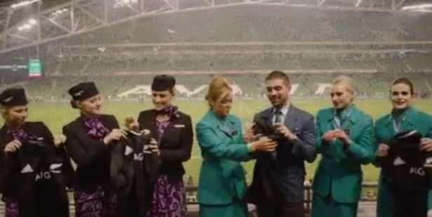Aer Lingus crew members are handed their All Blacks jerseys following their failed bet.
