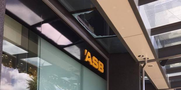 Shoppers at The Base in Hamilton were given a fright this afternoon when a pane of glass exploded outside ASB. Photo / Belinda Feek