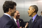 John Key (centre) has shared on his Twitter page this jokey moment with Justin Trudeau (left) and Barack Obama.