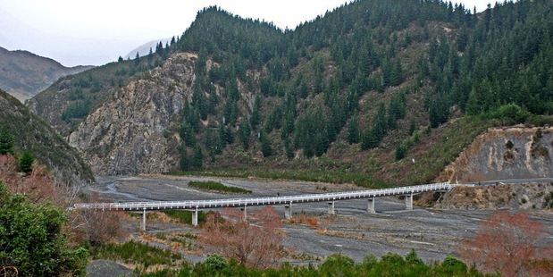 """The Conway River bridge on Inland Kaikoura Rd. Civil Defence is warning people to stay away from the river as a slip-formed dam in a tributary is in """"imminent danger"""" of overflowing. Photo / Wikimedia"""