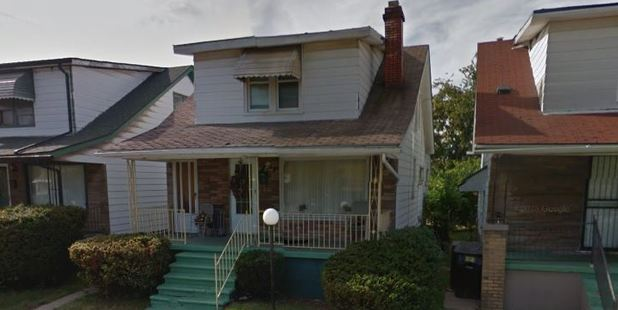 Police were shocked to discover three 'sex slaves' held captive inside a metal cage in an upstairs bedroom of this house in Detroit.