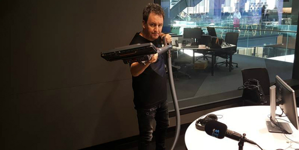 Mike Hosking and his beloved vacuum cleaner.