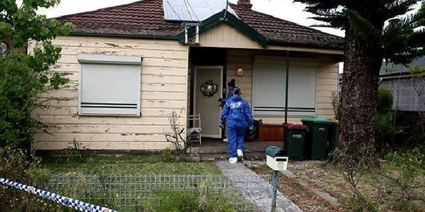 Forensic officers enter the house in Second St, Granville. Photo / Supplied