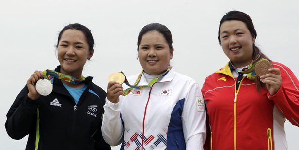 Lydia Ko celebrates with her Olympic silver medal alongside Olympic champion Inbee Park and bronze medallist Shanshan Feng. Photo / AP
