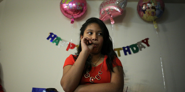 Dariela Acosta celebrates her 12th birthday with her family and friends in Rockville on Wednesday. Photo / Oliver Contreras / The Washington Post