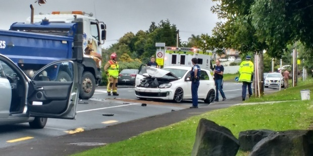 A man was arrested after trying to evade police before crashing the car he was driving on Don Buck Rd in West Auckland. Photo / Supplied via Jack Ekman