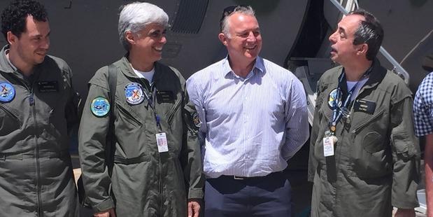 Flight engineer Leandro Bigarella, co-pilot William Souza and pilot Airton Manuoel Rodrigues with Grant Bradley.