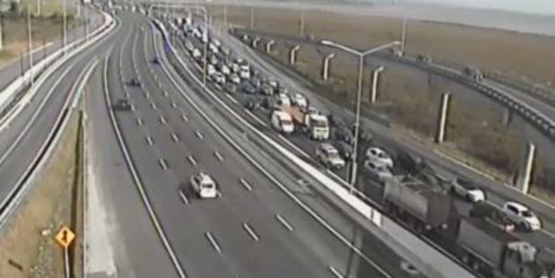 Loading Motorists are told to take public transport or expect to sit in traffic after incidents leave Auckland motorway crawling. Photo / NZTA