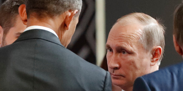 President Obama and Russia's President Vladimir Putin talked for four minutes in what appeared to be a frosty moment on the sides of the APEC Summit in Peru. Photo / AP