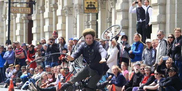 The crowds reaction to Oliver Briggs' spectacular tumble from his penny farthing. Photo / Hamish MacLean