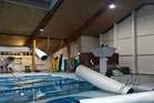 Last week's earthquake caused air conditioning ducts to collapse into Keith Spry Pool in Johnsonville. Photos / Supplied