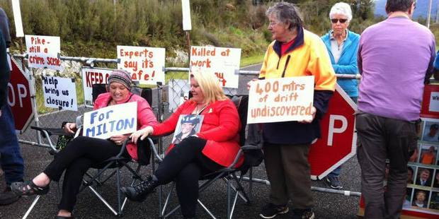 Pike River families, including Anna Osborne, left, and Sonya Rockhouse, centre, stage a protest against sealing the mine last week. Photo / Barry Uddstrom