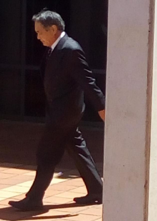 Masaaki Imaeda ducking out of Campbelltown Court on Thursday. Photo / news.com.au