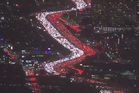'Lit up like a Christmas tree': Los Angeles' Interstate 405 clogged with holiday traffic.