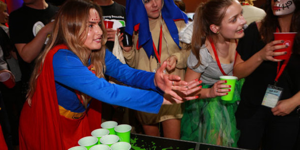 A competitor dressed as a superhero was one of over 500 people who took part in last year's KiwiPong National Championships. Photo / Supplied.