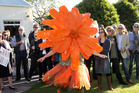 Display: Calendula, one of six human wildflowers at the opening party for the Wildflower Sculpture Exhibition, at Round Pond Garden held in support of the Cranford Hospice. Photo/Duncan Brown.