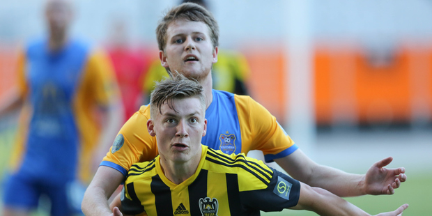 Wellington Phoenix Under 20's James McGarry and Southern United's Michael Hogan contest for the ball in the Stirling Sports Premiership at Forsyth Barr Stadium in Dunedin yesterday. Photo / Photosport