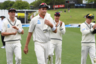 Tim Southee leads his teammates off the field after finishing with 6/80. Photosport
