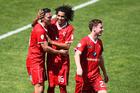Waitakere players celebrate Jake Butler's three goals against Tasman. Photo / Photosport