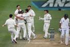 Neil Wagner is hugged by team mates as Pakistan batsman Imran Khan walks away and NZ win the series 2-0. Photo / Photosport