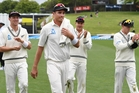 Bowler Tim Southee leads his team mates off the field after taking a 5 wicket haul finishing with 6/80. Photo / Photosport
