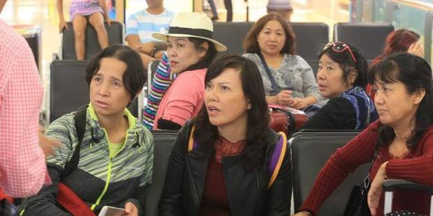 Concerned passengers at Sydney Airport after the frightening landing. Photo / News Corp Australia