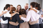 The group hug... not awkward at all. Photo / 123rf