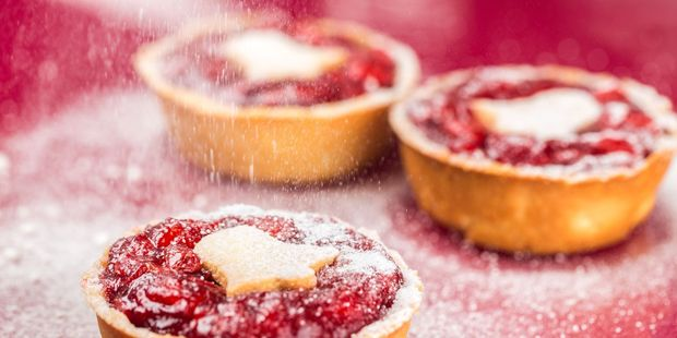 Mince pies date back to medieval times and were originally filled with a mixture of meat, dried fruit and spices. Photo / 123RF