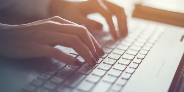 Woman working in home office hand on keyboard close up. Photo / 123rf