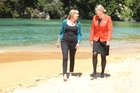 Kristin Paterson, left, and Jetstar cabin crew member Elle Shaw on the beach at the Kimi Ora Eco Resort, Nelson, with Whole Lotta Life.