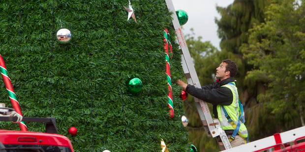 Loading This year's Christmas tree getting decorated.  Photo/Ben Fraser