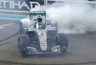 Mercedes driver Nico Rosberg of Germany celebrates after winning the 2016 world championship. Photo / AP