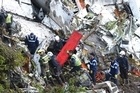 Colombian police release video shot by officers working at the site of a deadly plane crash in which more than 70 people died and only six survived Tuesday. (Source: AP)