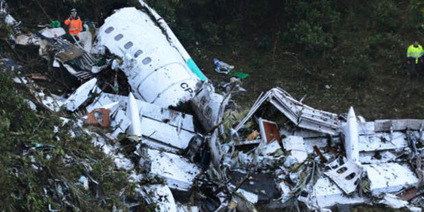 Loading Rescue workers stand at the wreckage site of a chartered airplane that crashed in a mountainous area outside Medellin, Colombia. Photo / AP