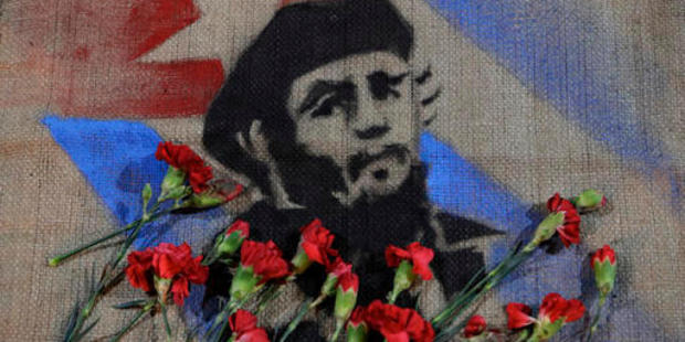 Flowers placed by members of Mexico's communist party lay on an image of late Cuban President Fidel Castro, outside the Cuban embassy in Mexico City. Photo / AP