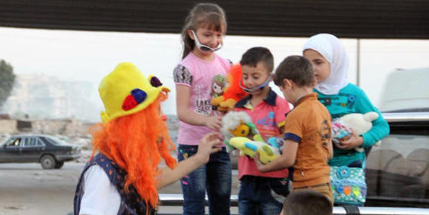 This undated photo shows Syrian social worker Anas al-Basha, 24, distributing toys to children in Aleppo, Syria. Photo / AP