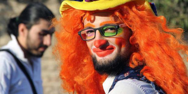 This undated photo courtesy of Ahmad al-Khatib, a media activist in Aleppo, shows Syrian social worker Anas al-Basha, 24, dressed as a clown. Photo / AP