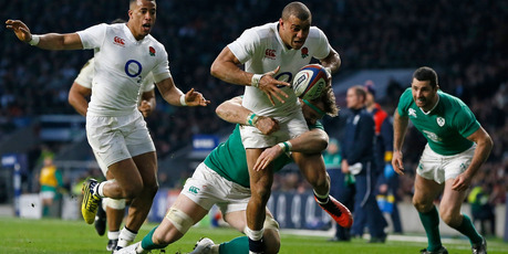 England's Jonathan Joseph is tackled just short of the line during the Six Nations international rugby match between England and Ireland. Photo / AP