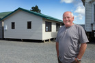 Craig Walker, who owns a building removal business in Kumeu, says so long as a house can be cut into reasonably sized chunks it can be moved and rebuilt. Photo/Brett Phibbs