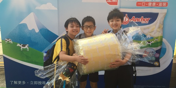 """Hong Kong children hold onto a giant model of the new """"Candy Cheese"""". Photo / Supplied"""