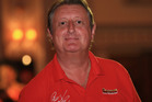 Darts legend Eric Bristow has caused uproar after a series of insensitive tweets about the football sex abuse scandal. Photo / Getty Images.