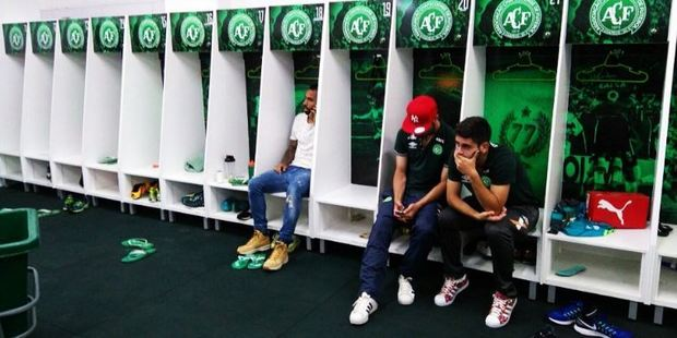 The heartbreaking photo showing Chapecoense players who did not travel with the team, sitting alone in an empty changing room. Photo / Twitter