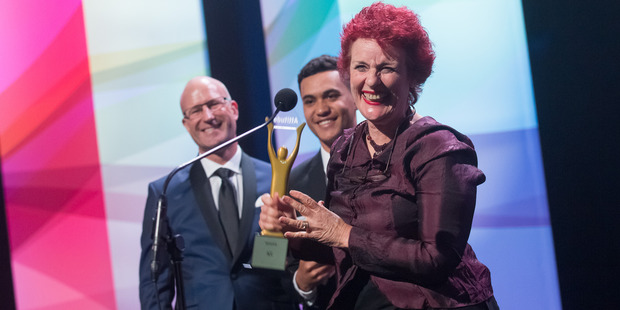 Boy star James Rolleston presents winner Debra Lampshire with the ACC Supreme Award at the Attitude Awards in Auckland. Photo/ Supplied