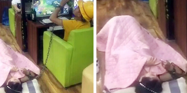 In photos of the bizarre incident the man can been swigging his beer while the girl lies beside him. Photo / AsiaWire
