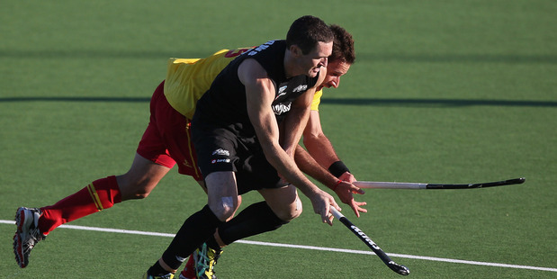 Phillip Burrowsin action against Spain. Photo / Getty Images