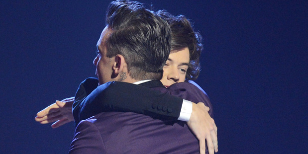 Robbie Williams presents Harry Styles of One Direction with the Global Success at The Brit Awards 2013. Photo / Getty