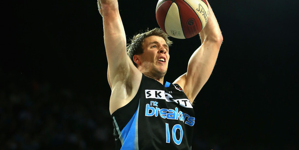 Tom Abercrombie dunks the ball. Photo / Getty Images