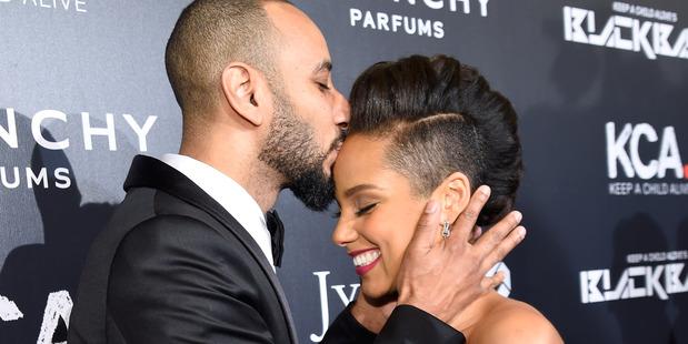 Swizz Beatz and wife Alicia Keys. Photo/ Getty