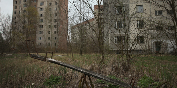 A children's seesaw stands among former apartment buildings on April 9, 2016 in Pripyat, Ukraine. Photo / Getty